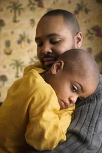 father comforts son